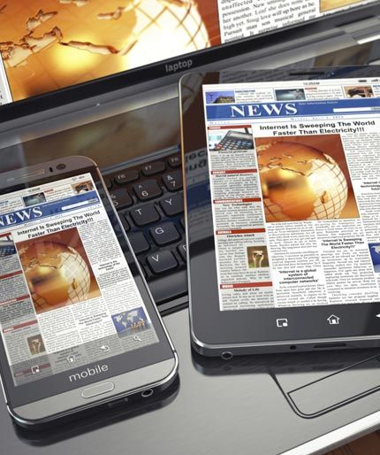 news headlines on mobile phone, tablet and laptop